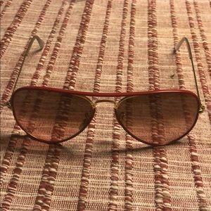 Red frame Ray Bans aviator sunglasses